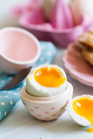 Series on boiled duck egg for breakfast, with toast soldiers Stock Photo