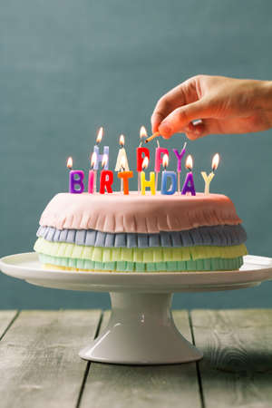 stash: Series on Pinata Cake, a celebration cake with a hidden stash of sweets inside. Stock Photo