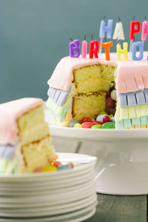 Series on Pinata Cake, a celebration cake with a hidden stash of sweets inside. Stock Photo