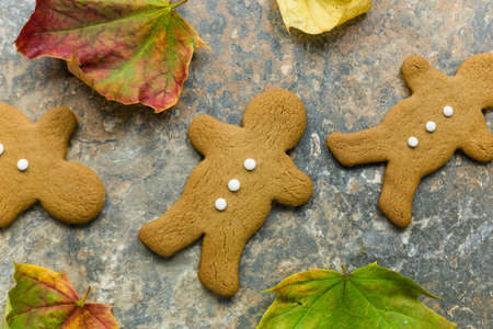 Gingerbread men on a rustic stone surface Stock Photo