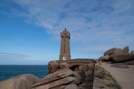 The pink granite coast at Ploumanac'h with the Mean Ruz lighthouse in Côtes-d'Armor in the Brittany region, France.