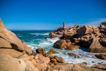 The pink granite coast at Ploumanac'h with the Mean Ruz lighthouse in Côtes-d'Armor in the Brittany region, France