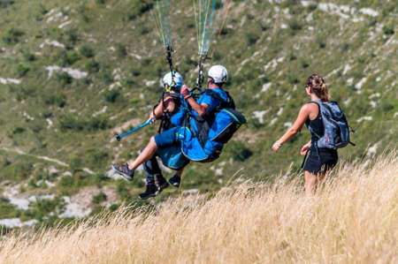 Paragliding flight over the Aveyron countryside in the Millau region in France.
