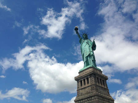 Statue of Liberty with Blue and Cloudy sky 報道画像