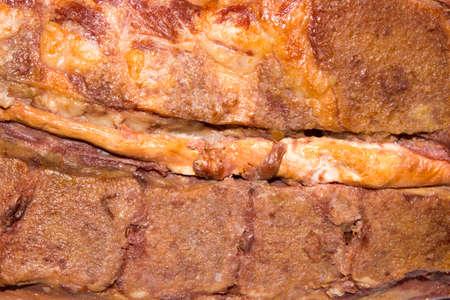 Smoked pork.Smoked pork ribs.Meat background. Foto de archivo - 104185219