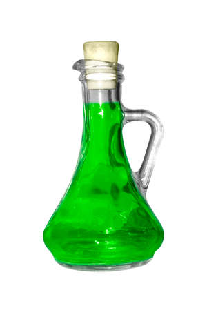 A glass flask with green substance on a white background. 스톡 콘텐츠