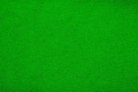 Braided green wool background.Green braided fabric texture. Stock Photo
