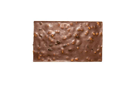 Milk chocolate with nuts and raisins on white background. 스톡 콘텐츠