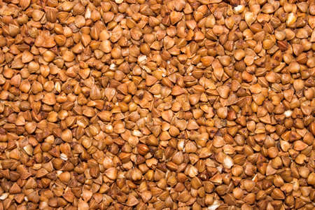 Buckwheat.Background of buckwheat.The texture of the buckwheat.