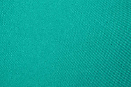 Dense light green fabric texture. Background of bright green fabric.