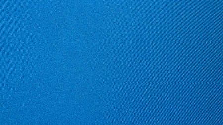 Blue light fabric texture.Turquoise braided fabric background.