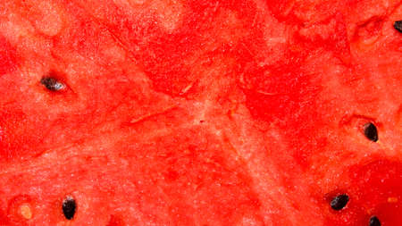 Ripe red watermelon.Texture of red watermelon with bones. Banco de Imagens - 128602803