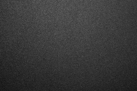 Texture of black matte plastic. Black and white matte background. Stockfoto