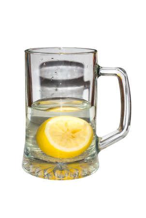 Mug transparent with lemon in water. Water with lemon. Reklamní fotografie