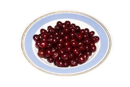 Cherry on a plate isolated on a white background. Reklamní fotografie