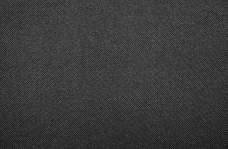 Texture of black dense fabric.Dark fabric background.