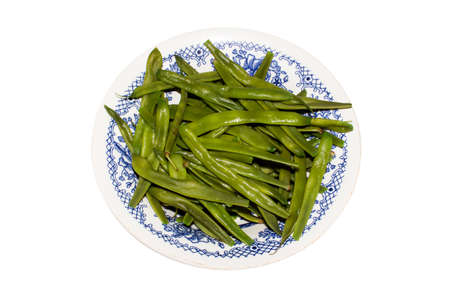 Beans on a plate.Background beans in pods.