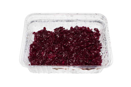 Beets grated on a white background.Beet salad with garlic in a container.