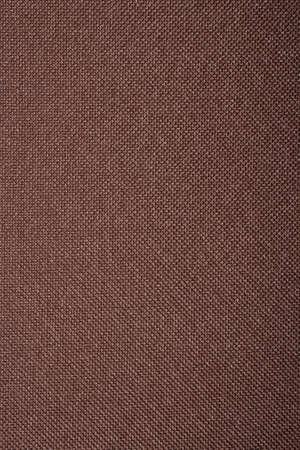 Texture of a dense brown fabric. Brown fabric background.
