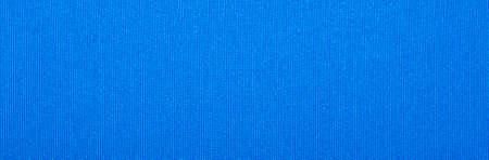 Blue dense fabric texture. Blue bright fabric background. Foto de archivo