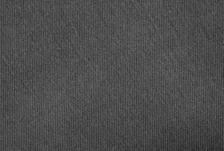 The fabric texture is fluted grey.The background of dense dark-gray patterned fabric. Фото со стока