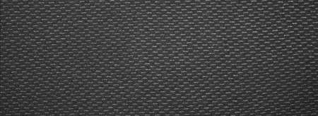 Dark gray texture with a speckled effect.The background is grey with white speckles.