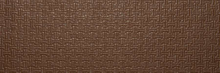 Texture of brown artificial leather with a pattern. The background is faux brown leather. Foto de archivo