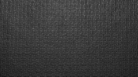 Texture of black artificial leather with a pattern.The background is faux black leather.
