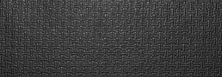 Texture of black artificial leather with a pattern.The background is faux black leather. Foto de archivo