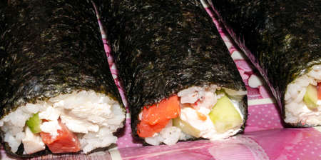 Sushi with fish and cucumber. Sushi prepared at home. 版權商用圖片