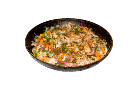 Fried meat with vegetables and herbs. Background of meat slices with vegetables.