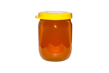 Bank of bee flower honey on a white background. Flower honey in a glass jar on a white background.