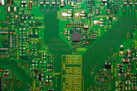 Electronic green printed circuit Board.Chip background.Texture of a computer chip with many elements.