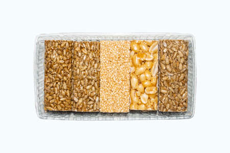 Fragile.Sunflower seeds with honey.Kozinaki in the range. Seeds, nuts, and sesame seeds.