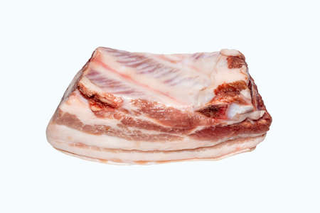 Fresh meat brisket with a layer of fat.A piece of pork belly on a white background.Pork tenderloin lard with meat.