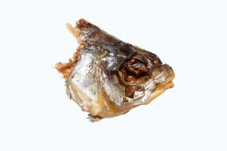 Fish head on a white. Dried fish head side view. Dried fish head.