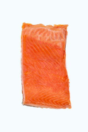 Top view of a single piece of salmon fillet isolated on a white background. Red fish tenderloins lightly salted. Stock fotó