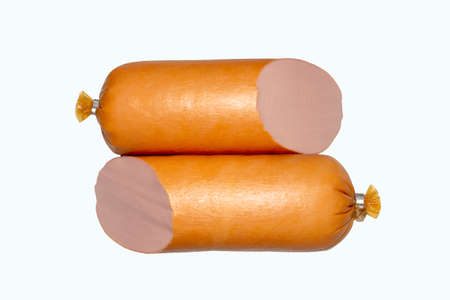 Stick of boiled sausage on a white background.Doctor's sausage isolated on a white background.
