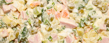 Olivier salad. The texture of the salad. Delicious salad Olivier as background, top view.