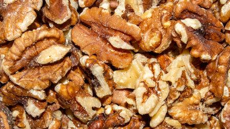 Background of peeled walnuts.Closeup of big shelled walnuts pile.Dry walnuts. Stock fotó
