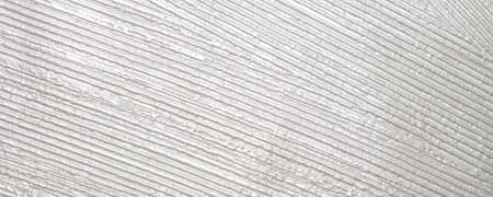 White fluted plaster background. The wall is plastered in a white stripe pattern.