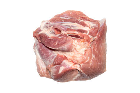 A piece of fresh pork meat on a white background. Pork tenderloin is the top view. A lump of raw meat. 免版税图像