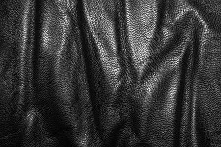 Black leather texture.Black leather background.Black leather with pleats.