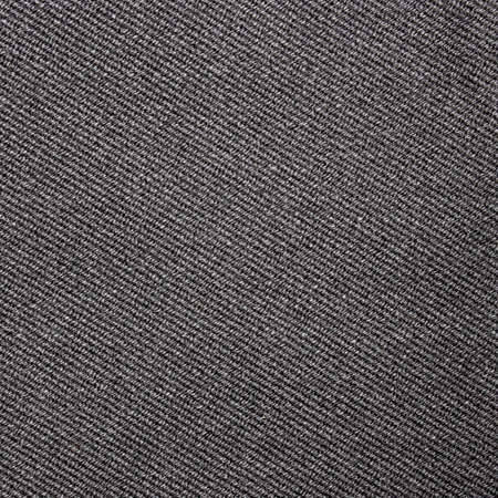 The texture of dark gray fabric is fluted in stripes. Background of dense gray fabric.