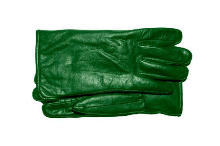 A pair of green leather gloves on a white background.Leather gloves top view.Leather gloves studio photo. 免版税图像