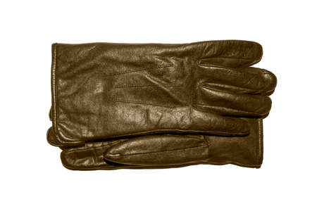A pair of brown leather gloves on a white background.Leather gloves top view.Leather gloves studio photo. 免版税图像