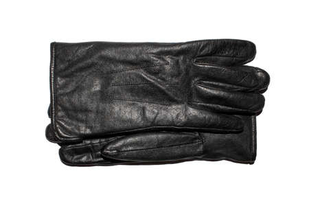 A pair of black leather gloves on a white background.Leather gloves top view.Leather gloves studio photo. 免版税图像