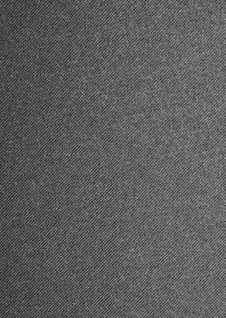 Dark gray denim background. The texture of black fluted denim.
