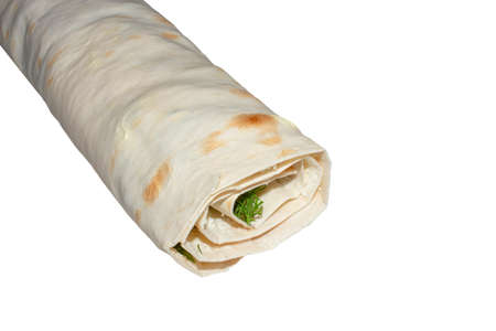 Pita bread rolls on a white background. Pita bread with filling, wrapped in a roll. A roll of pita bread on a white background.