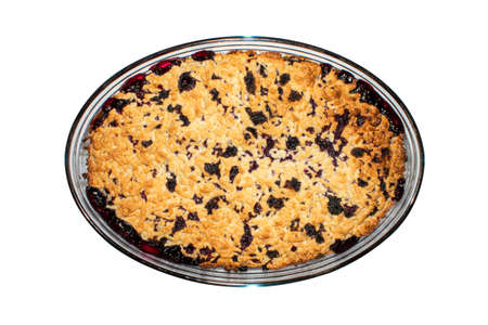 Shortbread cake with blueberries on a white background top view. Background oval dish of blueberry pie top view.